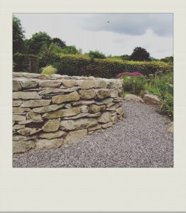 """natural stone wall in country garden"""